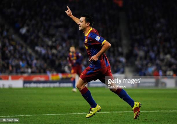 Xavi Hernandez of Barcelona celebrates after scoring his team's second goal during the La Liga match between Espanyol and Barcelona at Cornella El...