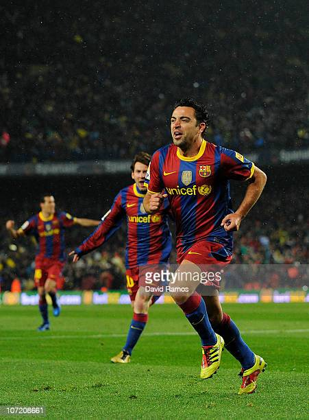 Xavi Hernandez of Barcelona celebrates after scoring the first goal during the La Liga match between Barcelona and Real Madrid at the Camp Nou...