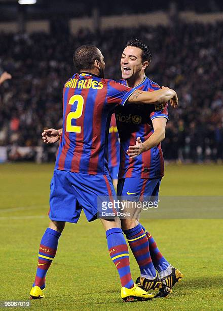 Xavi Hernandez of Barcelona celebrates with Dani Alves after scoring Barcelona's first goal in the La Liga match between Valladolid and Barcelona at...