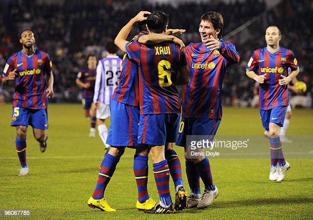 Xavi Hernandez of Barcelona celebrates with Lionel Messi after scoring Barcelona's first goal in the La Liga match between Valladolid and Barcelona...