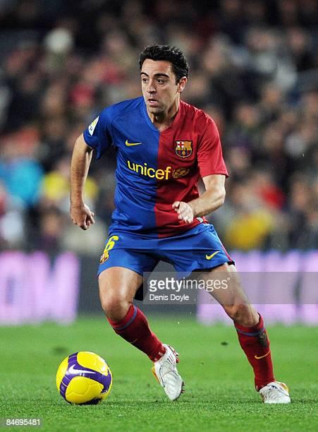 Xavi Hernandez of Barcelona controls the ball during the La Liga match between Barcelona and Sporting Gijon at the Camp Nou stadium on February 8...