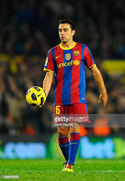 Xavi Hernandez of Barcelona holds the ball during the La Liga match between Barcelona and Villarreal CF at Camp Nou Stadium on November 13 2010 in...