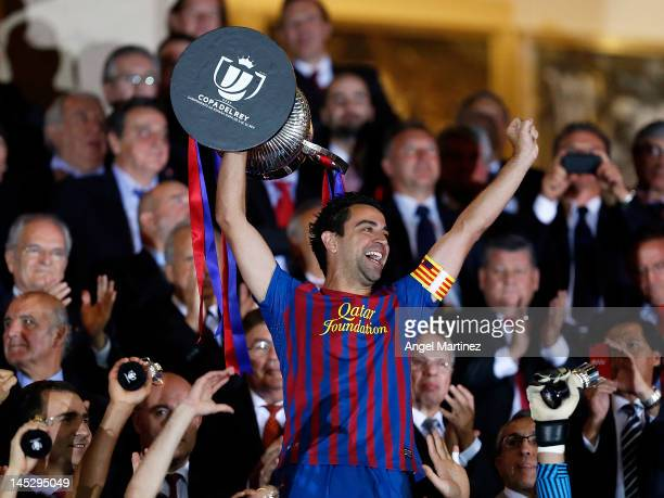 Xavi Hernandez of Barcelona holds the trophy in celebration after a victory in the Copa del Rey Final match between Athletic Bilbao and Barcelona at...