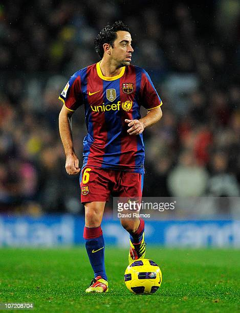 Xavi Hernandez of Barcelona in action during the La Liga match between Barcelona and Real Madrid at the Camp Nou Stadium on November 29 2010 in...