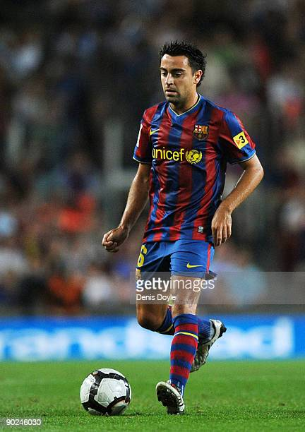 Xavi Hernandez of Barcelona in action during the La Liga match between Barcelona and Sporting Gijon at the Nou Camp stadium on August 31 2009 in...