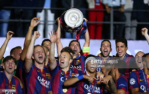 Xavi Hernandez of Barcelona lifts the trophy as he celebrates victory with team mates after the UEFA Champions League Final between Juventus and FC...