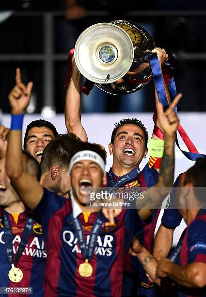 Xavi Hernandez of Barcelona lifts the trophy as he celebrates victory with Neymar after the UEFA Champions League Final between Juventus and FC...