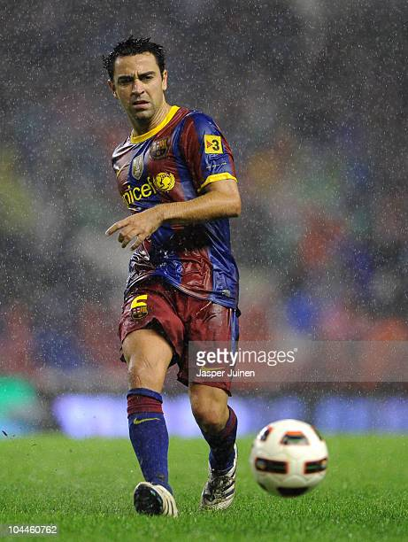 Xavi Hernandez of Barcelona passes the ball during the La Liga match between Athletic Bilbao and Barcelona at the San Mames Stadium on September 25...