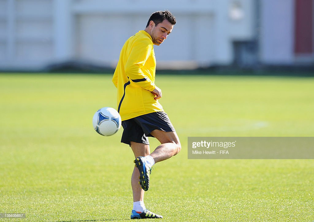 Xavi Hernandez of Barcelona practises a back heel during the Barcelona training at Marinos Town on December 12, 2011 in Yokohama, Japan.