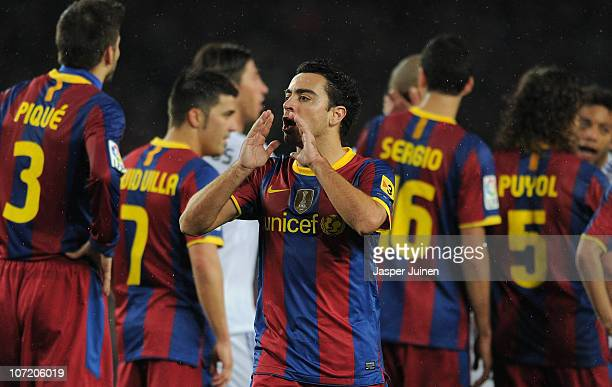 Xavi Hernandez of Barcelona reacts to his teammates during the la liga match between Barcelona and Real Madrid at the Camp Nou stadium on November 29...