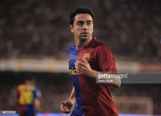 Xavi Hernandez of Barcelona runs over to take a corner kick during the La Liga match between Valencia and Barcelona at the Mestalla stadium on April...
