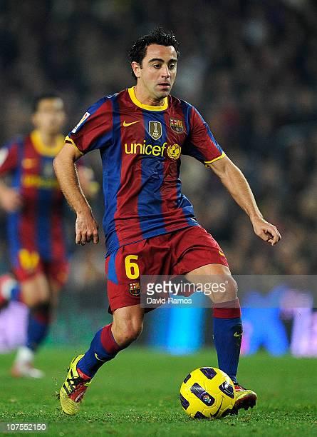 Xavi Hernandez of Barcelona runs with the ball during the La Liga match between Barcelona and Real Sociedad at Camp Nou Stadium on December 12 2010...