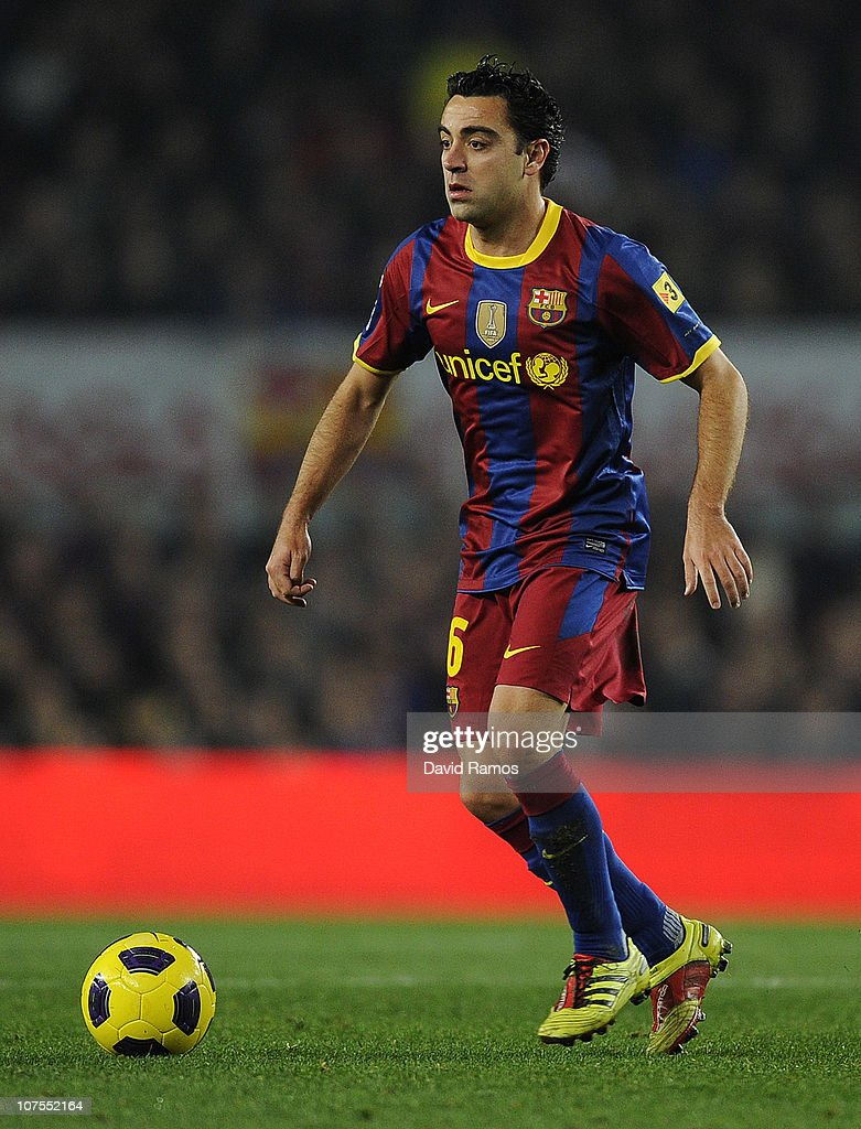 Xavi Hernandez of Barcelona runs with the ball during the La Liga match between Barcelona and Real Sociedad at Camp Nou Stadium on December 12, 2010 in Barcelona, Spain. Barcelona won 5-0.
