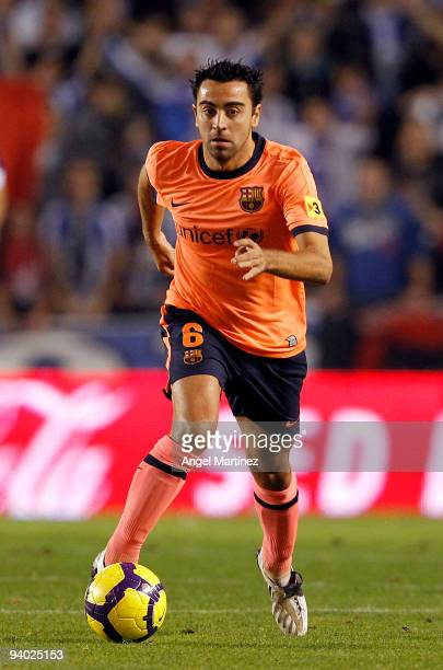 Xavi Hernandez of Barcelona runs with the ball during the La Liga match between Deportivo La Coruna and Barcelona at the Riazor stadium on December...