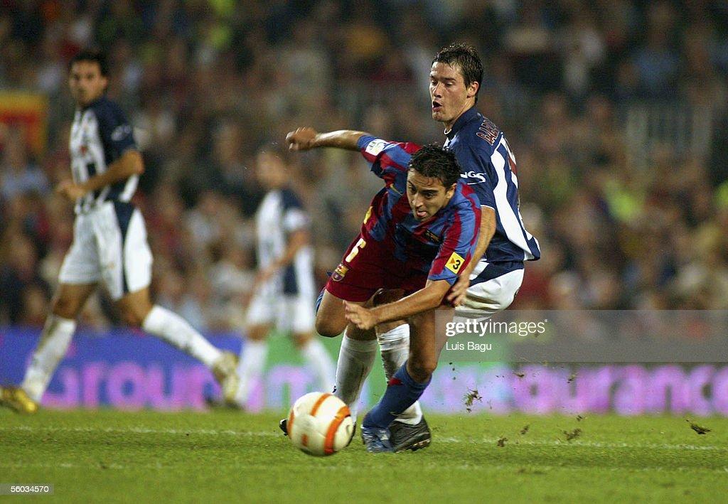 Xavi Hernandez of FC Barcelona and Igor Gabilondo of Real Sociedad in action during the La Liga match between FC Barcelona and Real Sociedad, on October 30, 2005 at the Camp Nou stadium in Barcelona, Spain.