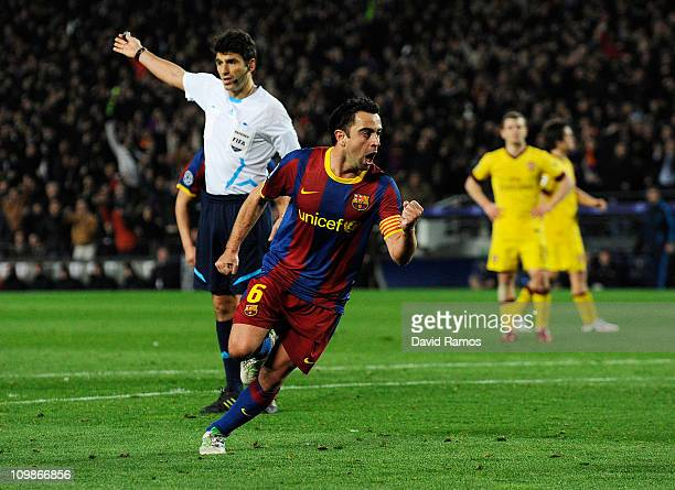 Xavi Hernandez of FC Barcelona celebrates after scoring his team's second goal during the UEFA Champions League round of 16 second leg match between...