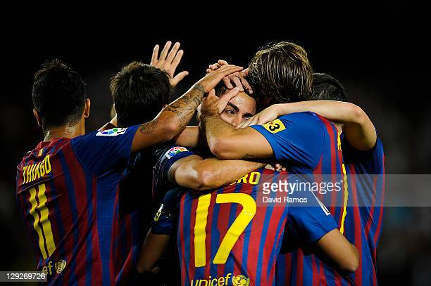 Xavi Hernandez of FC Barcelona celebrates with his teammates after scoring his second team's goal during the La Liga match between FC Barcelona and...