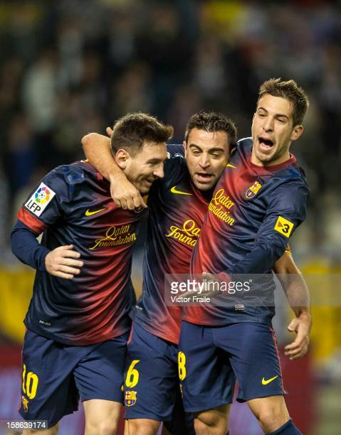 Xavi Hernandez of FC Barcelona celebrates with his teammates Lionel Messi and Jordo Alba after scoring against Real Valladolid at Jose Zorrilla on...