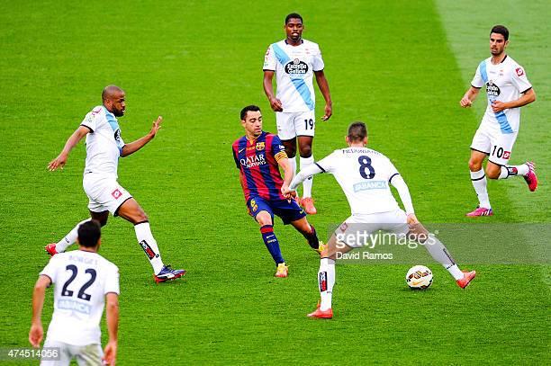 Xavi Hernandez of FC Barcelona controls the ball among RC Deportivo La Coruna players during the La Liga match between FC Barcelona and RC Deportivo...