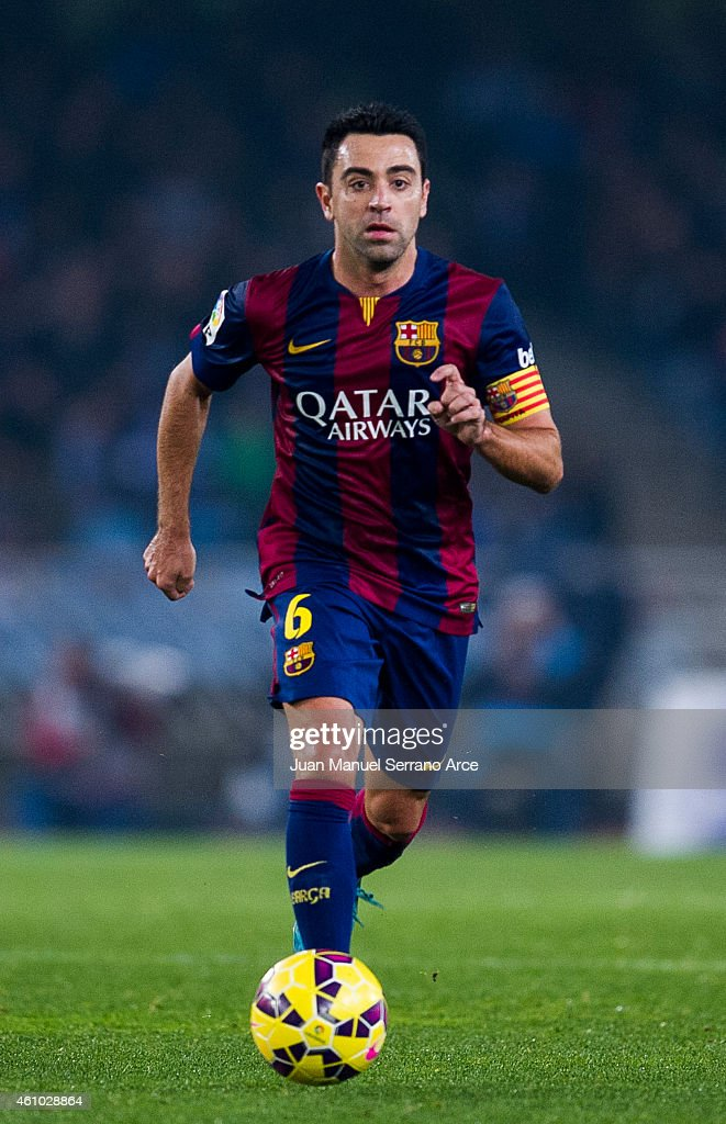 Xavi Hernandez of FC Barcelona controls the ball during the La Liga match between Real Sociedad and Barcelona at Estadio Anoeta on January 4, 2015 in San Sebastian, Spain.
