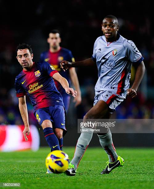 Xavi Hernandez of FC Barcelona duels for the ball with Raoul Cedric 'Raoul Loe' of CA Osasuna during the La Liga match between FC Barcelona and CA...