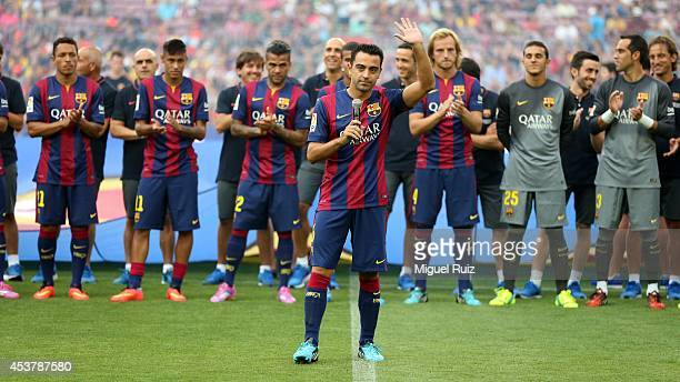 Xavi Hernandez of FC Barcelona gives a speech to the supporters before the Joan Gamper Trophy match between FC Barcelona and Leon CF at Camp Nou on...