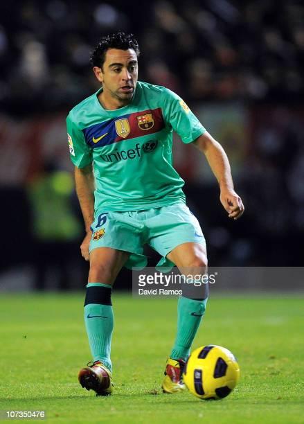 Xavi Hernandez of FC Barcelona goes for the ball during the La Liga match between CA Osasuna and Barcelona at Estadio Reyno de Navarra on December 4...