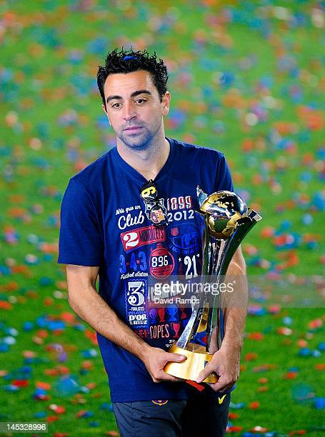 Xavi Hernandez of FC Barcelona holds the FIFA Club World Cup Trophy during the FC Barcelona celebrations following the club's victory of the Copa del...