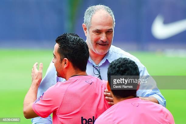 Xavi Hernandez of FC Barcelona hugs FC FC Barcelona Sport Director Andoni Zubizarreta during a FC Barcelona training session at Ciutat Esportiva de...
