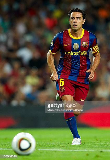Xavi Hernandez of FC Barcelona in action during the Spanish Supercopa second leg match between Barcelona and Sevilla at the Camp Nou stadium on...