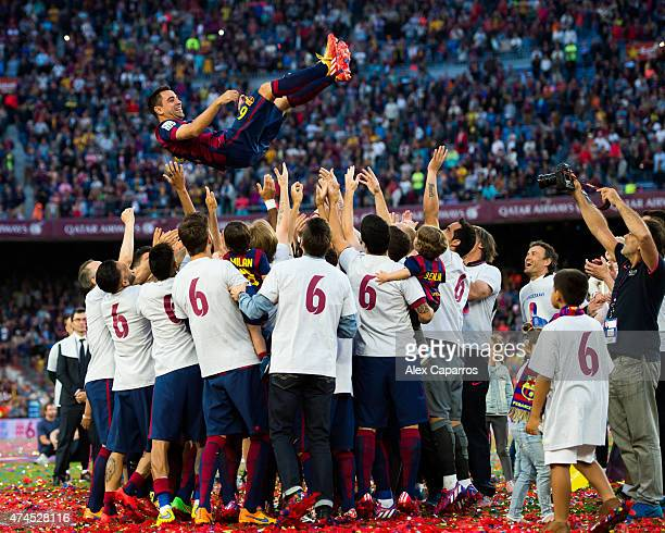 Xavi Hernandez of FC Barcelona is tosed by his teammates after the La Liga match between FC Barcelona and RC Deportivo La Coruna at Camp Nou on May...