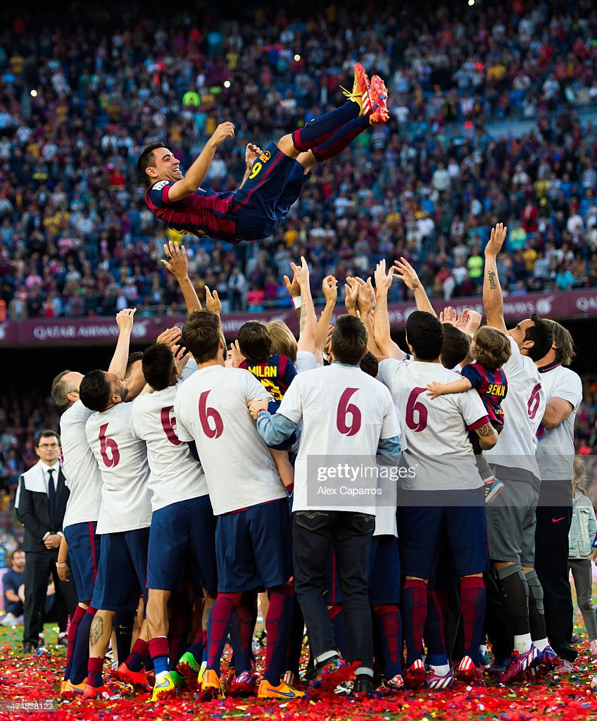 Xavi Hernandez (top) of FC Barcelona is tosed by his teammates after the La Liga match between FC Barcelona and RC Deportivo La Coruna at Camp Nou on May 23, 2015 in Barcelona, Spain.