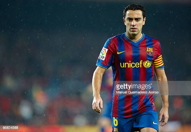 Xavi Hernandez of FC Barcelona looks on during the La Liga match between Barcelona and Sevilla at the Camp Nou stadium on January 16 2010 in...