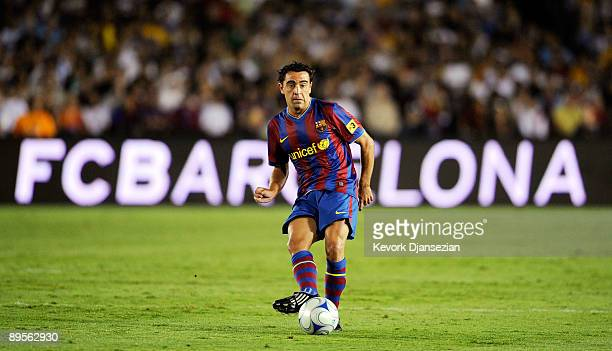 Xavi Hernandez of FC Barcelona passes the ball during the second half of the friendly soccer match against the Los Angeles Galaxy at the Rose Bowl on...