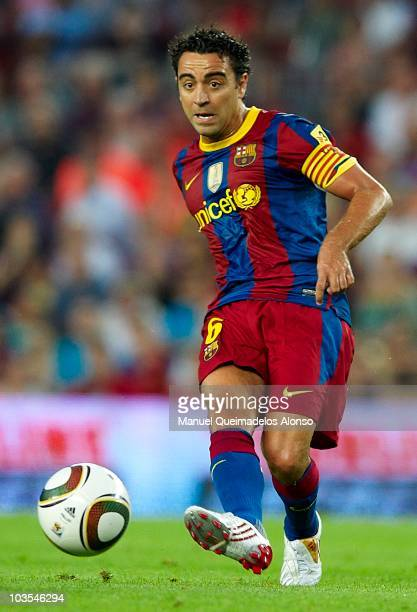 Xavi Hernandez of FC Barcelona passes the ball during the Spanish Supercopa second leg match between Barcelona and Sevilla at the Camp Nou stadium on...
