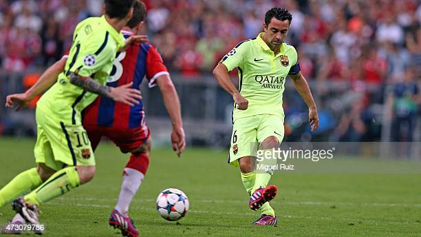 Xavi Hernandez of FC Barcelona passes the ball during the UEFA Champions League semifinal 2nd round match between FC Bayern Muenchen and FC Barcelona...