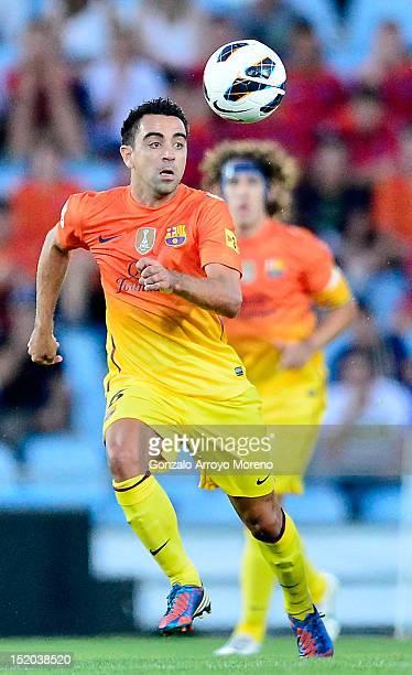 Xavi Hernandez of FC Barcelona runs for the ball during the La Liga match between Getafe CF and FC Barcelona at Coliseum Alfonso Perez on September...