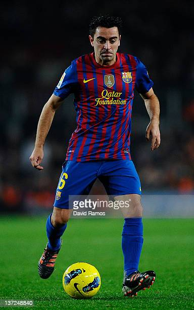 Xavi Hernandez of FC Barcelona runs with the ball during the La Liga match between FC Barcelona and Real Betis Balompie at Camp Nou on January 15...