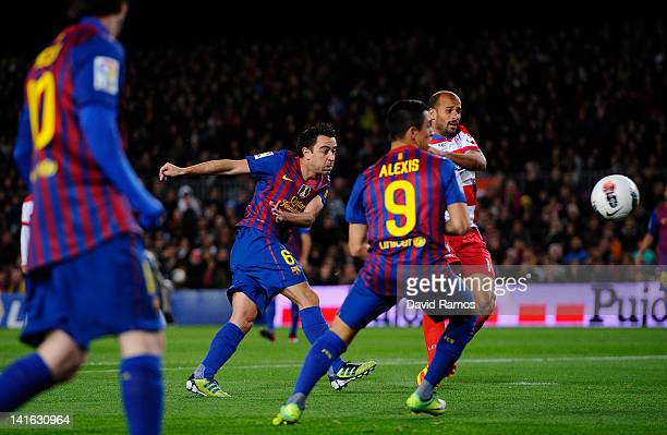 Xavi Hernandez of FC Barcelona scores the opening goal during the La Liga match between FC Barcelona and Granada CF at Camp Nou on March 20 2012 in...