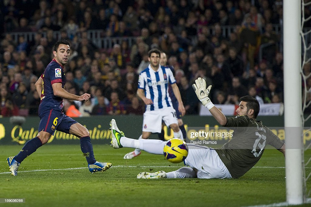 Xavi Hernandez of FC Barcelona scores the opening goal during the La Liga match between FC Barcelona and RCD Espanyol at Camp Nou on January 6, 2013 in Barcelona, Spain.