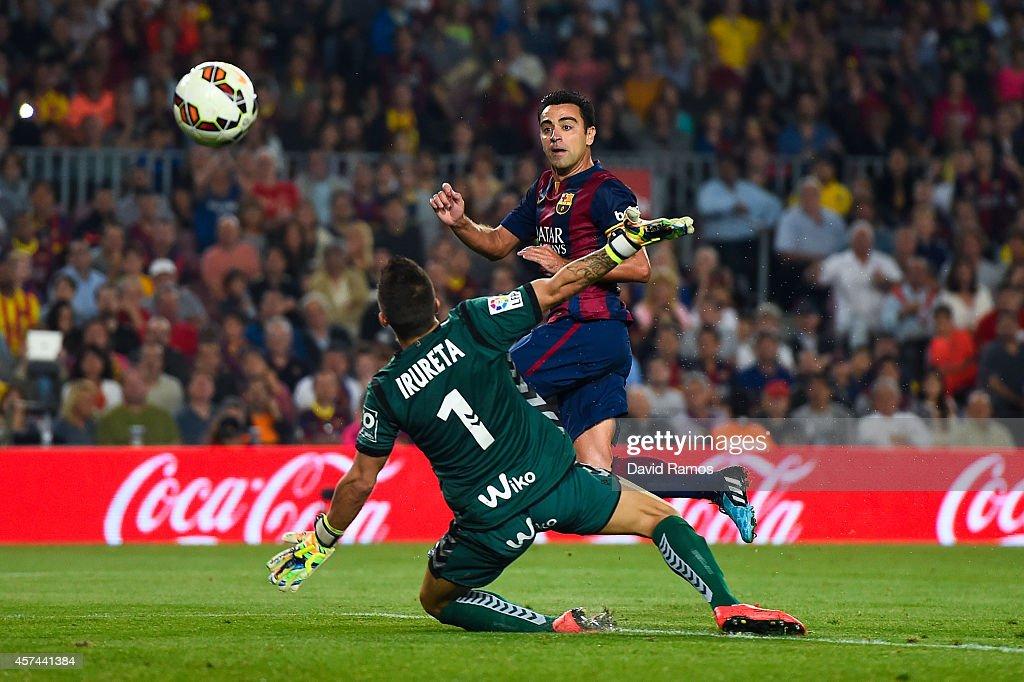 Xavi Hernandez of FC Barcelona scores the opening goal past Xabi Irureta of SD Eibar during the La Liga match between FC Barcelona and SD Eibar at Camp Nou on October 18, 2014 in Barcelona, Spain.