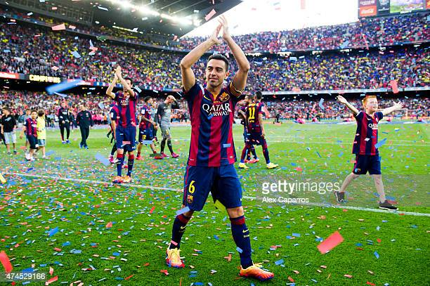 Xavi Hernandez of FC Barcelona waves to the spectators after the La Liga match between FC Barcelona and RC Deportivo La Coruna at Camp Nou on May 23...