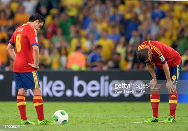 Xavi Hernandez of Spain and Fernando Torres of Spain show their dejection after conceding a third goal during the FIFA Confederations Cup Brazil 2013...
