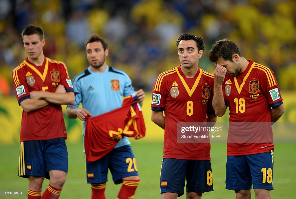 Xavi Hernandez of Spain and Jordi Alba (R) look dejected at the end of the FIFA Confederations Cup Brazil 2013 Final match between Brazil and Spain at Maracana on June 30, 2013 in Rio de Janeiro, Brazil.
