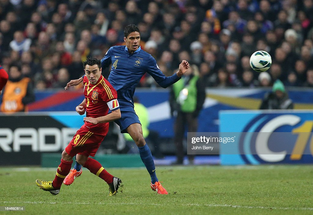 Xavi Hernandez of Spain and Raphael Varane of France in action during the FIFA World Cup 2014 qualifier match between France and Spain at the Stade de France on March 26, 2013 in Saint-Denis near Paris, France.