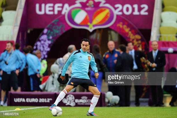 Xavi Hernandez of Spain controles the ball during a UEFA EURO 2012 training session ahead of their Group C match against Italy at the Municipal...
