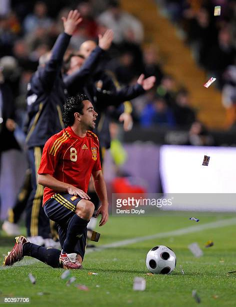 Xavi Hernandez of Spain gets up after being fouled by Fabio Grosso of Italy during the friendly International soccer match between Spain and Italy at...