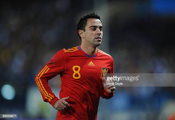 Xavi Hernandez of Spain goes to take a corner kick during the International friendly match between Argentina and Spain at the Vicente Calderon...