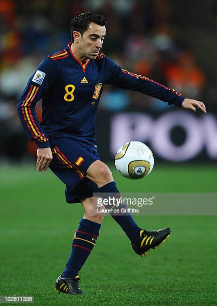 Xavi Hernandez of Spain in action during the 2010 FIFA World Cup South Africa Final match between Netherlands and Spain at Soccer City Stadium on...