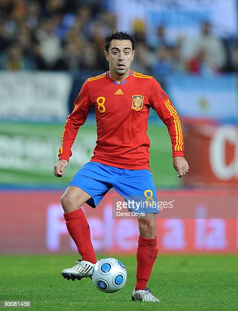 Xavi Hernandez of Spain in action during the International friendly match between Argentina and Spain at the Vicente Calderon stadium on November 14...